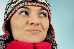 Attractive woman in woolen cap portrait Stock Footage
