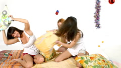 Young girls fight with pillow - christmas scene Stock Footage