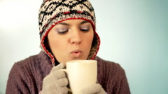 Young Woman in woolen cap drinking hot tea / coffee  Stock Footage