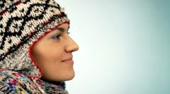 Woman in woolen cap blowing Stock Footage