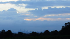 Sunrise over London with stormy clouds Stock Footage