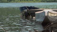 Ducks in River With Row Boats - stock footage