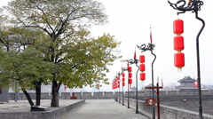 Red dragon flag along and Lantern in the top of Xian City Wall - stock footage