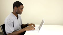 Young man working on laptop - stock footage