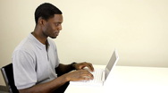 Young man working on laptop Stock Footage