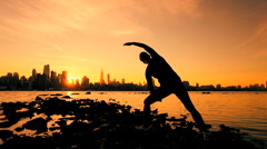 Practicing Yoga at Sunrise Stock Footage