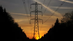 Electricity Pylons at dusk Stock Footage