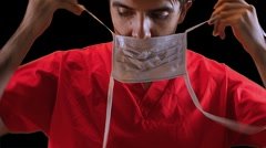 T303 doctor putting on mask surgical sugery Stock Footage