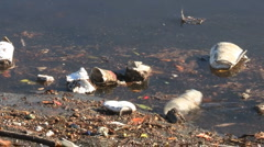 Polystyrene And Plastic Garbage Floating In Water Stock Footage