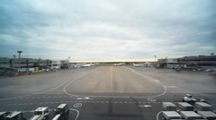 Vision of  airports field with lorries on it through window Stock Footage