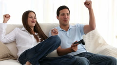 Man playing video games with his girlfriend - stock footage