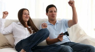 Stock Video Footage of Man playing video games with his girlfriend