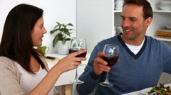 Couple toasting with red wine during the lunch Stock Footage