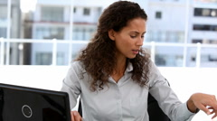 Businesswoman talking on phone in office Stock Footage