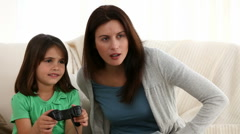 Mother and daughter playing video games - stock footage