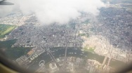 Stock Video Footage of vision of London city from  airplane flying high over it