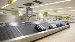 Moving luggage belf with bags in airport in London, UK. Stock Footage