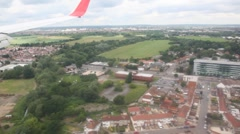 View of huge car parking through window out from airplane during landing Stock Footage