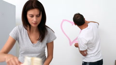 Man drawing a heart on the wall Stock Footage
