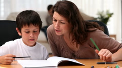 Stock Video Footage of Mum doing homework with her son