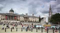 People walks on  Trafalgar Square near National Gallery in London, UK. Stock Footage