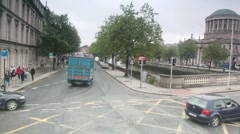 Cars and peoples moving on street of Dublin Stock Footage