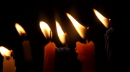 Stock Video Footage of Candles in the Darkness , Close-up 1080HD