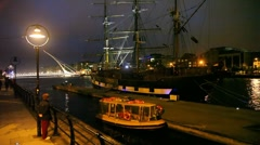 Big ship is standing near evening wharf, Samuel Beckett Bridge in  distance Stock Footage