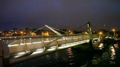 people walks on night Sean O'Casey bridge in Dublin, Ireland - stock footage