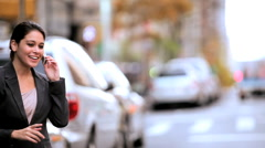 Young City Businesswoman Hailing a Cab Stock Footage