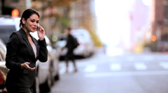 Stock Video Footage of Businesswoman with Cell Phone Getting a Cab