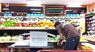 Stock Video Footage of Grocery Store Clerk Restocking