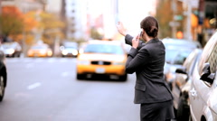 Businesswoman Hailing a Cab - stock footage