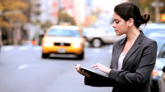 Using a Wireless Tablet on City Streets - stock footage