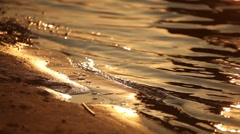 Waves wash sand - stock footage