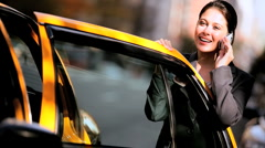 Businesswoman by City Taxi with Cell Phone - stock footage