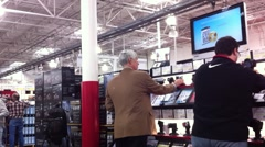 Men Shopping for Electronics Stock Footage
