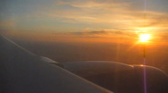 Stock Video Footage of Airplane Flying at Sunset