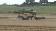 Stock Video Footage of New Holland combine harvester on wheat.