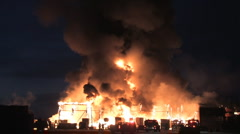Industrial Fire engulfs lumber warehouse Stock Footage