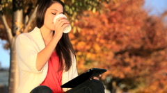 Pretty Girl With Coffee & Wireless Tablet Stock Footage