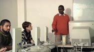 Computer class with teacher and students at school Stock Footage