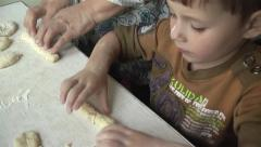 Child helps his grandmother. to work with the test Stock Footage