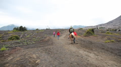 Tourists walking at Bromo volcano Stock Footage