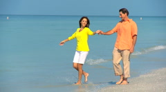 Attractive Couple Having Fun on the Beach Stock Footage