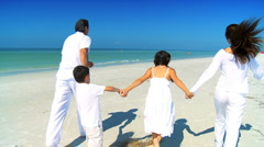 Attractive Young Family Beach Vacation Stock Footage