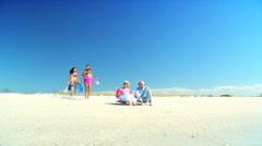 Three Generations of Family Enjoying the Beach Stock Footage