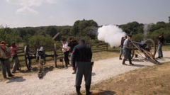 American Civil War cannon fires across wooded valley Stock Footage