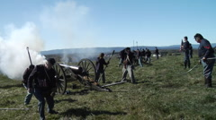 American Civil War artillery firing at confederates Stock Footage