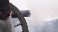 Closeup from the side of an American Civil War cannon firing Stock Footage